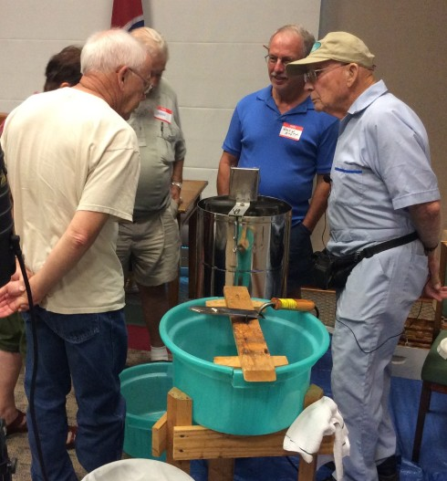 John Gee, far right, discusses extracting equipment with some of the members of the BCBA.